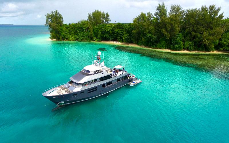 112ft motor yacht AKIKO anchored off island in Papua, New Guinea