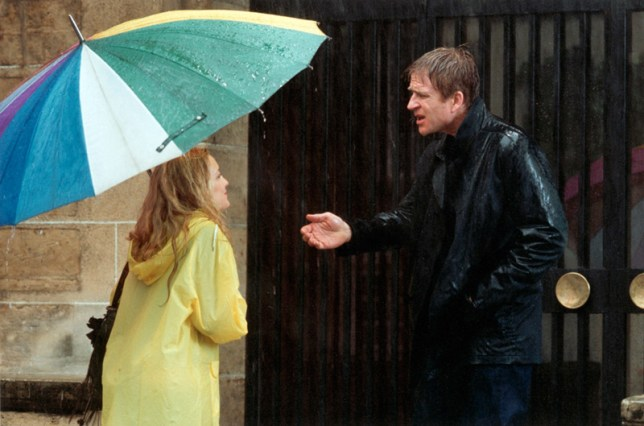 09_Isabel and Tellman in rain