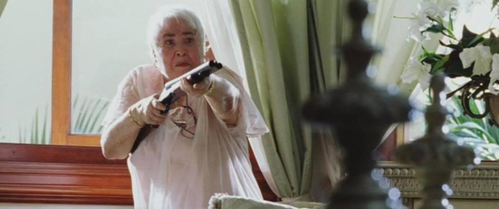 17. Mama Tapia with gun
