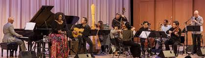 photo of Bill Childs leading Dianne Reeves (singing), Larry Koonse (guitar), Carol Robbins (harp) and other members of orchestra