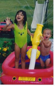 elise and jacob playing in kiddie pool