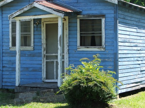 crooked blue house