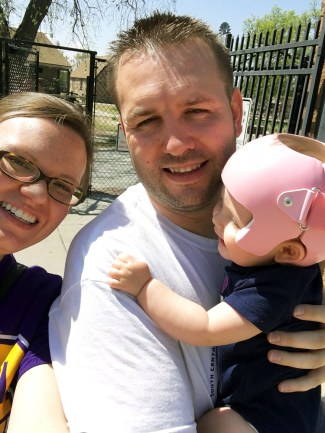 plagiocephaly baby first trip to zoo with daddy and mommy