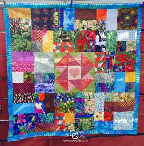 Scrappy quilt with orphan block