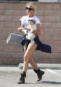 ASHLEY BENSON with Her Dog Stopping for a Snack