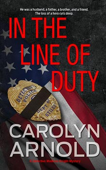 In the Line of Duty by Carolyn Arnold badge with morning band covering the middle of the badge resting on a rippled US flag.