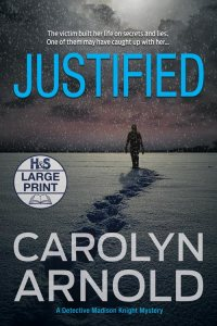 Justified Large Print Edition by Carolyn Arnold, a silhouette of a man walking away leaving footprints in the snow at night