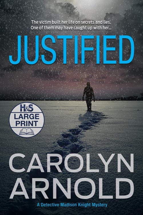 Justified Large Print Edition by Carolyn Arnold