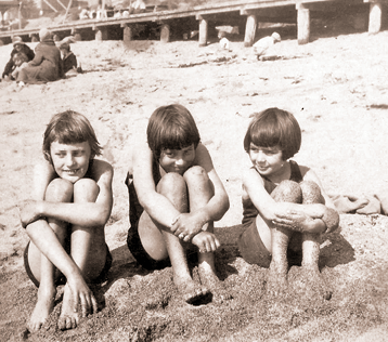 Little Carolyn with two older cousins from her father's side. Carolyn is on the right.