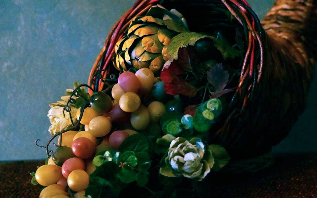 straw cornucopia filled with artichokes, grapes and more representing the web design and development resources listed