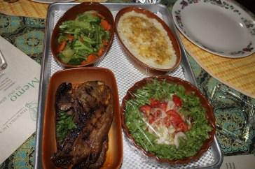 Baked lamb, mashed yams, veggies and salad