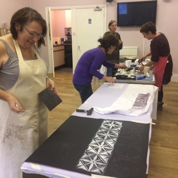 Image of participants at a printmaking on fabric printingworkshop held by artist and printmaker Carolyn Murphy in 2017