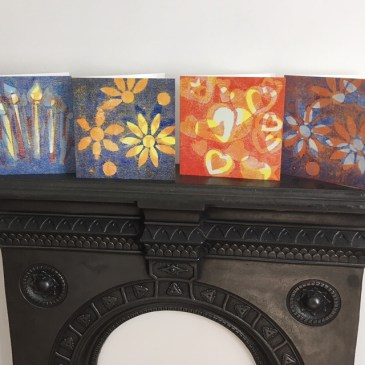Image of 4 greetings cards on a mantelpiece