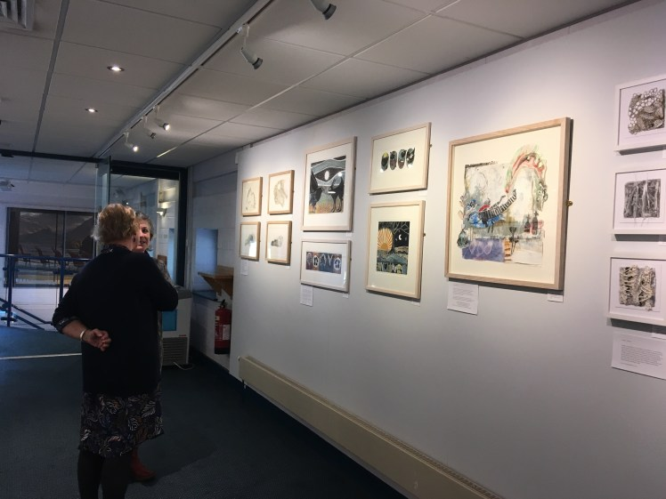 Image of two of the artists at the private view at the Keswick exhibition