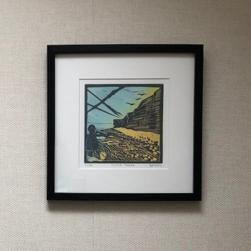 Image of Distant Pebbles framed on the wall at Carolyn's home