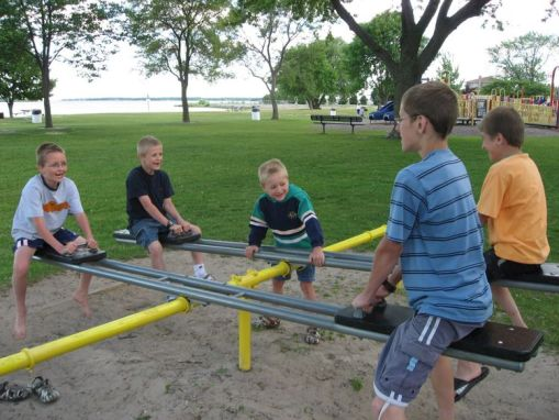 Teeter-tottering at Starlight Park in Alpena