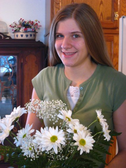 Kristi with birthday flowers from her Dad