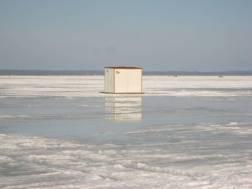 Snow melting around an ice shanty