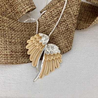 Carol Young Silver gold & silver Wing EaNecklace