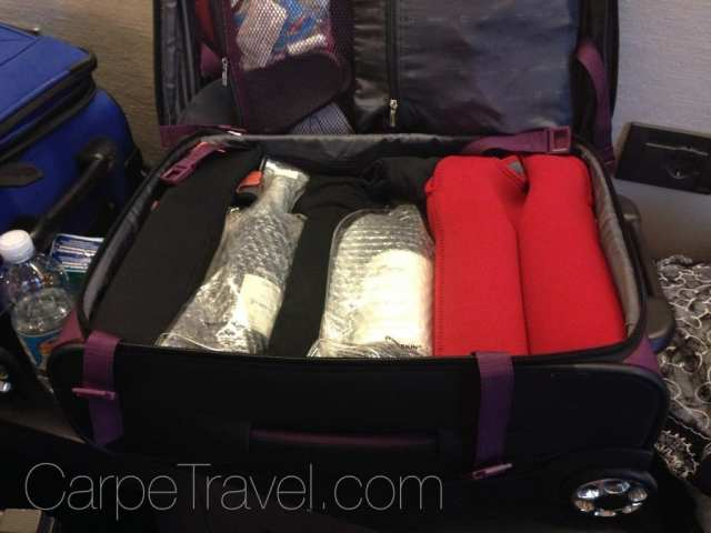 A Guide to Traveling Home with Wine. Tip Two: wine in checked luggage. Click through for tips on how to pack wine in a suitcase