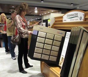 Member Bonnie Anderson inspects new Stainmaster Pet Protect display