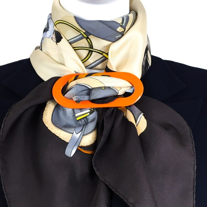 GRAND LUXE REVERSIBLE ORANGE/HORN SCARF RING $ 49.50