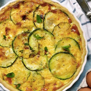 La recette de la quiche à la courgette et à la tomme :