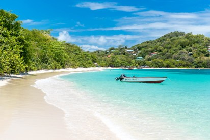 Carriacou paradise beach with small boat.