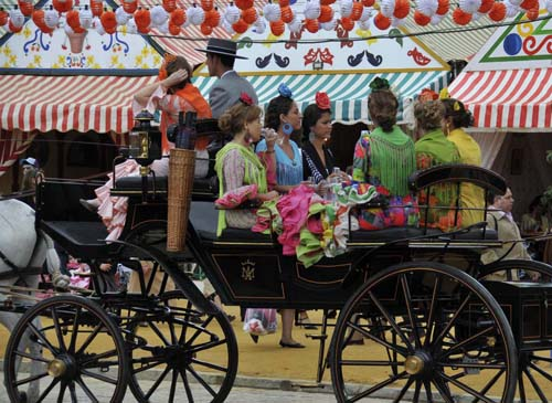 with the casetas and the traditional outfits, the feria is wonderfully colorful