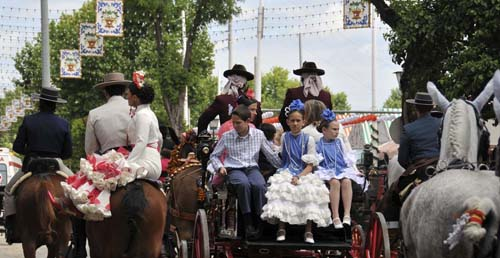 hildren on the back of a carriage and a lady sitting on a horse in the traditional style