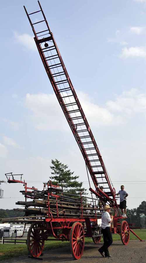 Willi explained how the ladder wagon would've worked, while a couple of volunteers hand-cranked the main ladder to a portion of its 65-foot height
