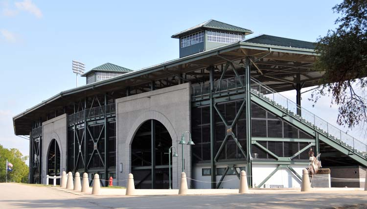 """the grandstand structure of the KHP's new outdoor arena, as seen from the """"people entrance"""" on Nina Bonnie Blvd"""