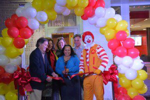 (LEFT TO RIGHT) Mark Gompels; Nina Gompels; Gloria Brack-Ford, SCCPSS; Kim Newman, Isle of Hope School Principal; Anjanie Gaouette, Store Manager; Larry Tate, Area Supervisor; and Ronald McDonald cut ribbon on new Montgomery Cross Rd location.