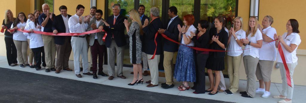 Key Influencers and staff cut the ribbon on one of the largest child development centers in Georgia, the Angel Learning Center. (LEFT TO RIGHT) Ashlee Reiser, Zoe Fernandez, Kelsey Zittrouer, Jennifer Hilton, John King, Matt Dowling, Adam Yanco, Danny Pinyan, Savan Patel, Mayor Eddie DeLoach, Laukik Patel, Sheri Showalter, Major Mike Lamb, Jay Patel, Cinda Young, Erica Rivera, Elizabeth Simons, Janisha Patel, Carly Hendrix, Chelsea Lukes, Stacy Hunte, Andrea Best Hensley