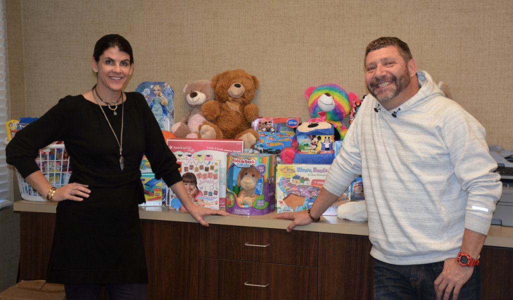 (LEFT TO RIGHT) Corinne Howington of Low Country Dermatology presents donations collected for the Ronald McDonald House to executive director Bill Sorochak