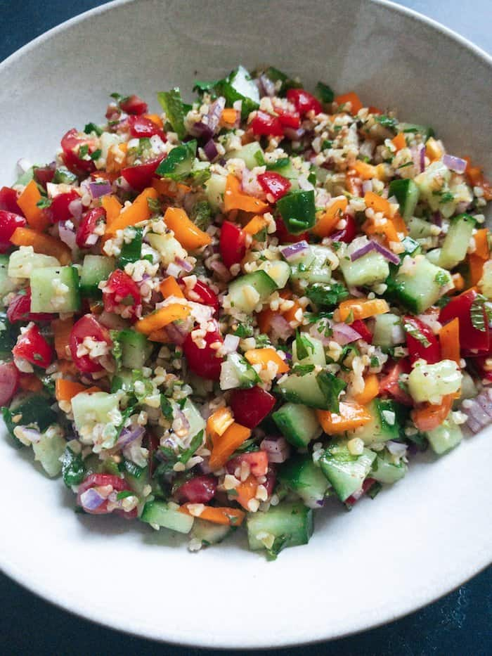 Tabbouleh Style Bulgar Salad - A Lebanese inspired Tabbouleh Salad with Bulgar wheat, peppers, tomatoes and cucumbers with a fresh citrus and sumac dressing. Easy to prepare and keeps well in the fridge for the perfect quick dinner. A great no-cook dish which can be easily made ahead!