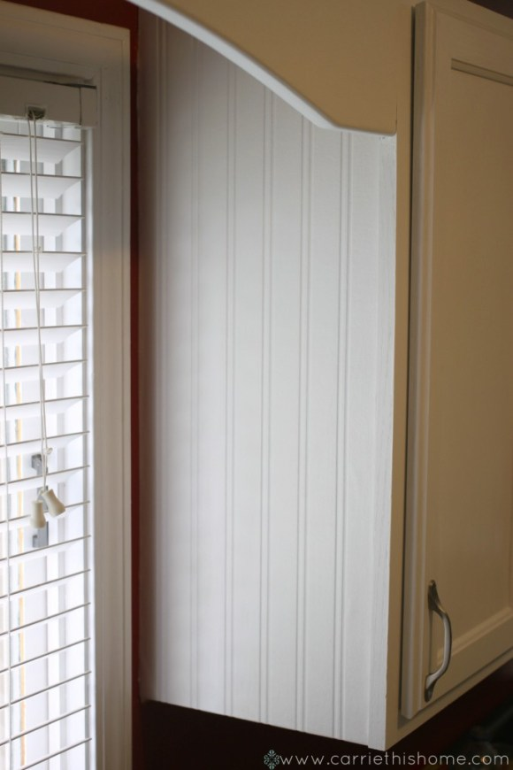 Wainscoting wallpaper on the end of cabinet