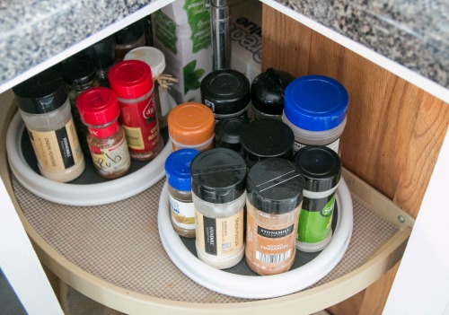 Genius idea! Use little lazy susans to organize your spices.