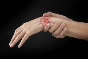photo of wrist bone injury on black background