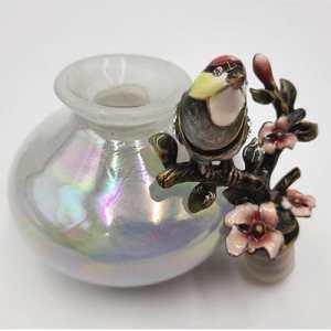 Perfumero con decoración de aves