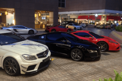 Mercedes AMG C63 Coupe, Audi R8, Ferrari 458 Italia, McLaren MP4, BMW M3. Singapore street scene