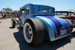 Custom blue Ford coupe with white wall racing slicks parked at the Good Guys Columbus Car Show in 2018.