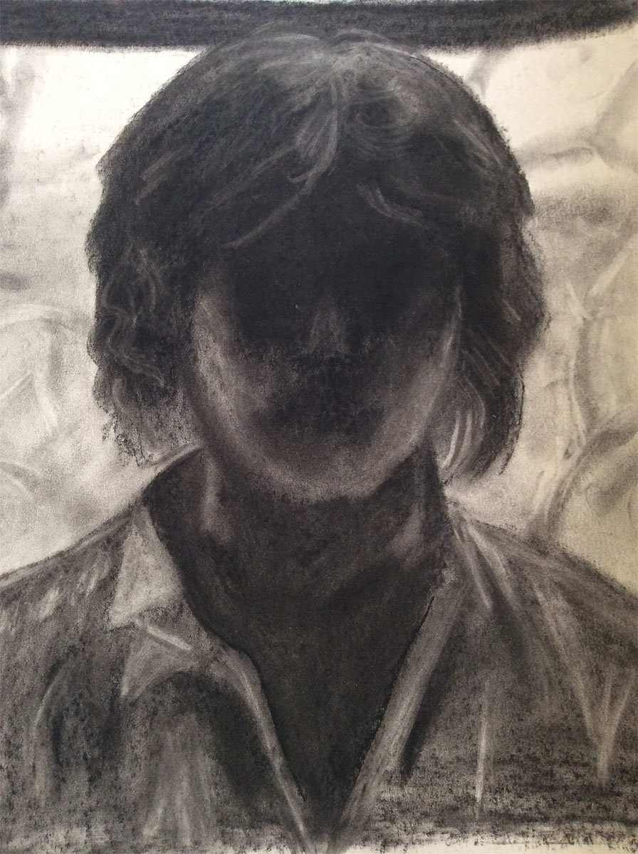 charcoal portrait of a person in dark shadow drawn by Susan Carson