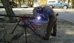 Patrick welding an extension to one of the cooling pipes.