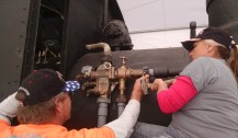 Brian and his wife tightening up collars on the injector plumbing.