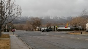 A winter storm rolls over the Sierra's with Ray's Den Motel in the foreground.