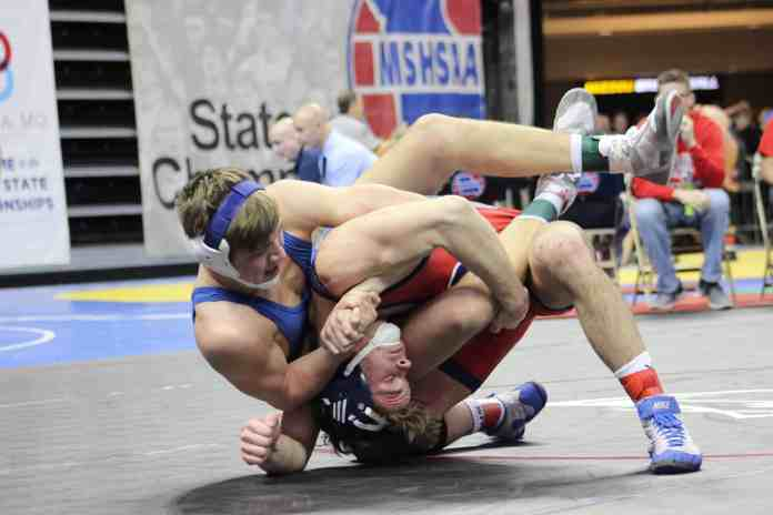 Senior Kelten Campbell claims an 8-3 decision over his Liberty North opponent in the second round wrestlebacks. Crystal Brown / Carthage News Online