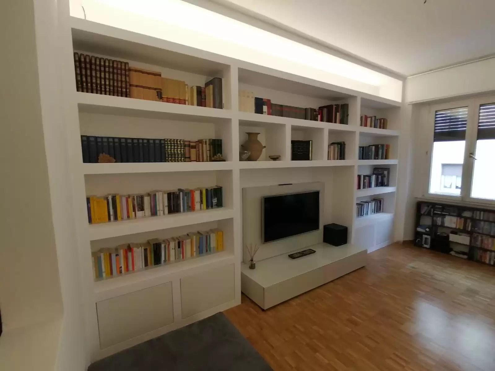 Realizziamo pareti attrezzate moderne in cartongesso per qualsiasi tipo di stanza, in particolare per cucine e soggiorni. Realizzazione Librerie In Cartongesso Firenze Cartongesso Design