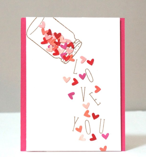 hearts and letters that spell love being poured from a jar on this card