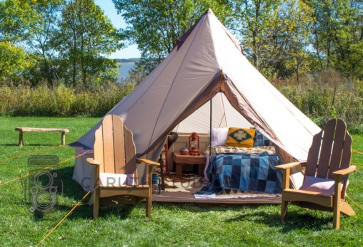 tipi style tent on grassy field